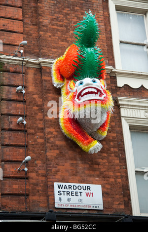 Chinese lion dog in Wardour Street, Chinatown, London, England, UK - Stock Photo