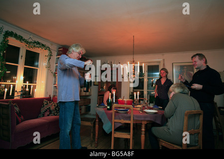 united kingdom a middle aged group of people around the dinner table - Stock Photo