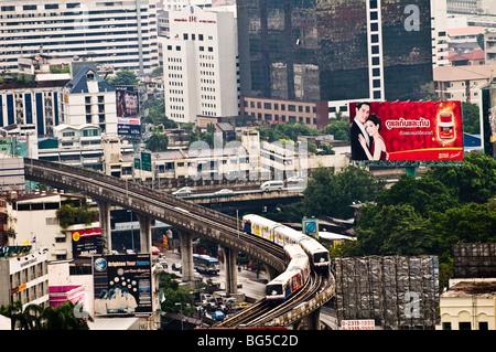 The BTS sky train approaches Sapan Taksin station in Bangkok. - Stock Photo