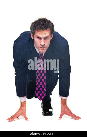 Businessman in a starting position, isolated on a white background. - Stock Photo