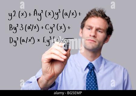 Teacher writing on a glass screen - Stock Photo