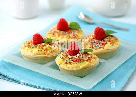 Mango cream tartlets. Recipe available. - Stock Photo