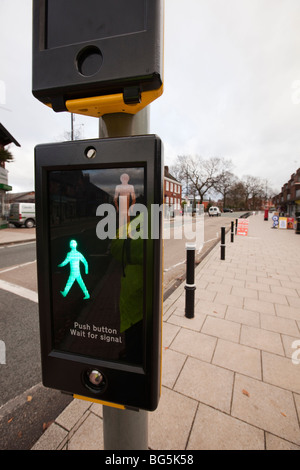 Road Safety, Pelican Crossing green man walk light signalling safe to cross surburban road - Stock Photo