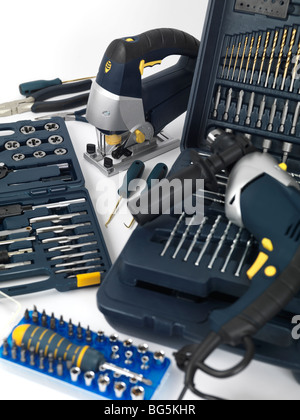Electric drill, a jigsaw, thread cutting dies and taps, drill bits and other tools - Stock Photo