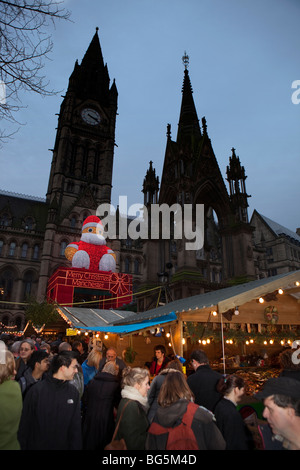 UK, England, Manchester, Albert Square, crowds in Continental market outsideTown Hall - Stock Photo