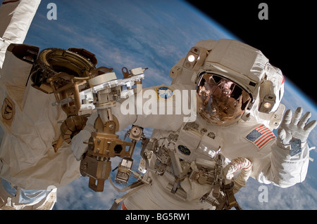 Astronaut Clay Anderson during spacewalk working on International Space Station - Stock Photo