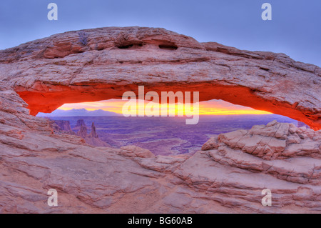 Sunrise on Mesa Arch, Island in the Sky, Canyonlands National Park, Utah - Stock Photo