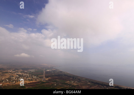 Israel, Lower Galilee, a view of Migdal and the Sea of Galilee from Mount Arbel - Stock Photo