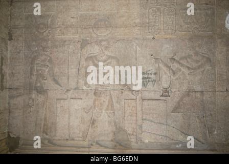 Reliefs on a wall at Temple of Kom Ombo at night in Egypt - Stock Photo