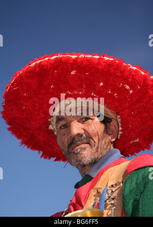 Portrait of  a Water Carrier at Jemaa el Fna  Marrakech - Stock Photo