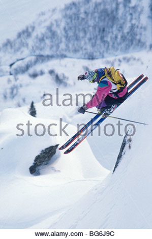 Alaska. Chugach Mts. Valdez. Winter, A skier attemps extreme slopes during the World Extreme Ski Competitions. - Stock Photo