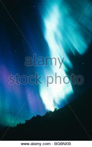 Alaska. In intense dislpay of northern lights (Aurora borealis) turns white hot. - Stock Photo