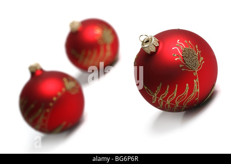 Three Red Christmas Balls Isolated On White Background. Tilt view, shallow DOF. - Stock Photo
