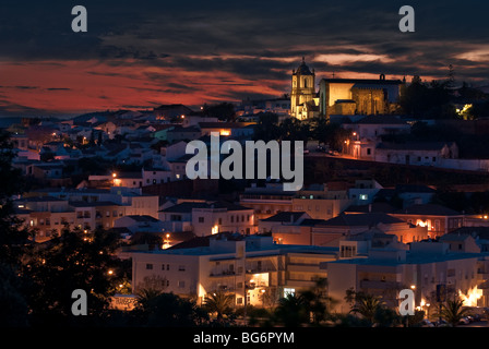 View of Silves at Dusk, Sé Catedral de Silves top right - Stock Photo
