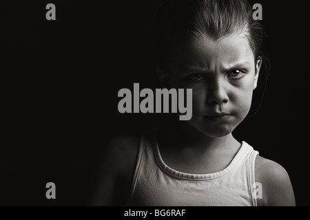 Powerful Low Key Shot of a Child with Attitude - Stock Photo