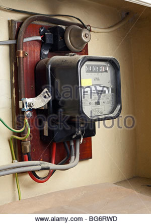 Domestic Electricity meter in a British house - Stock Photo