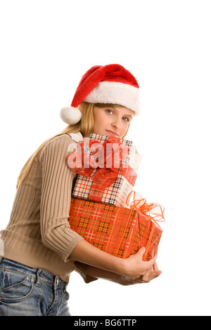 Portrait of pretty teenage girl holding pile of gifts isolated on white background - Stock Photo