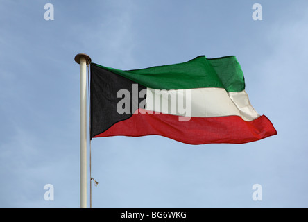 The national flag of the Gulf oil emirate of Kuwait. - Stock Photo