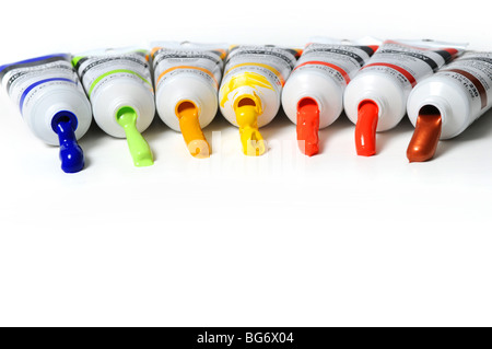 Multicolor tubes of paint over a white background - Stock Photo