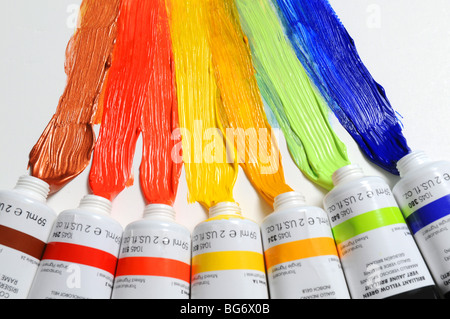 Paint of different colors spread over a white background - Stock Photo