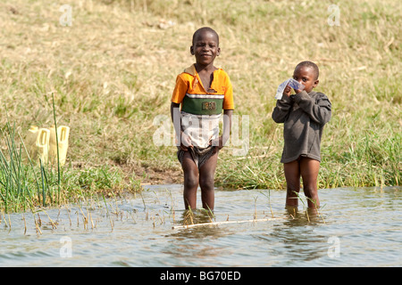 Two young Ugandan boys from a fishing village within Queen Elizabeth National Park in Uganda, East Africa - Stock Photo
