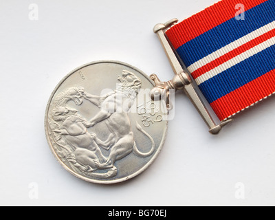 Close up of the reverse side of a World War 2 Medal awarded to British and Commonwealth Troops 1939-45 on a white - Stock Photo