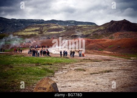People at geothermal area in Haukadalur in Iceland. - Stock Photo