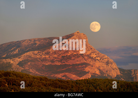 Full Moon Rising or Moon Rise over Mont Sainte Victoire Montain, near Aix-en-Provence or Aix en Provence France - Stock Photo