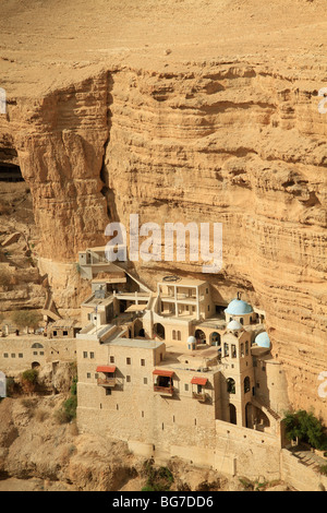 Judean Desert, Greek Orthodox St. George Monastery on the slope of Wadi Qelt - Stock Photo