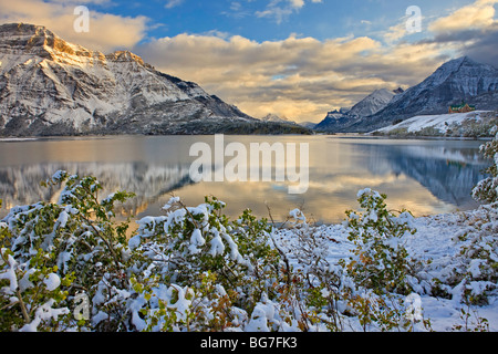 Prince of Wales Hotel opposite Mt Vimy and overlooking Middle Waterton Lake after the first snowfall of winter, - Stock Photo