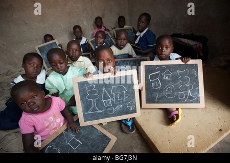 Young children display drawings in an orphanage in Amuria, Uganda, East Africa. - Stock Photo