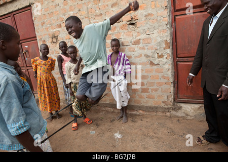 Orphaned children play outside an orphanage in Amuria, Uganda, East Africa. - Stock Photo