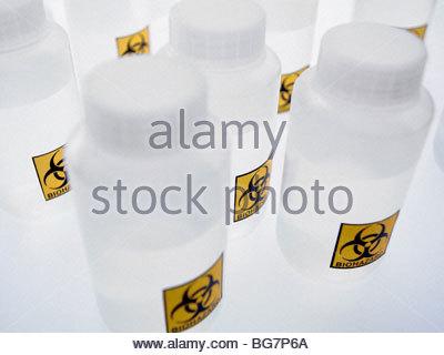 Biohazard labels on plastic bottles - Stock Photo