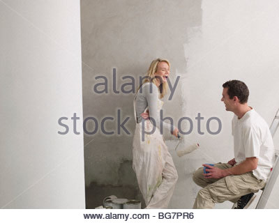 Couple painting wall - Stock Photo