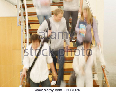 College students moving on staircase - Stock Photo