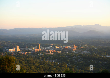 Sunset view of the heart of downtown Asheville, NC as seen from town mountain. - Stock Photo