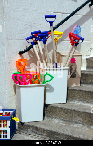 COLOURFUL SEASIDE TOYS ON SALE AT AN ENGLISH SEASIDE RESORT. - Stock Photo