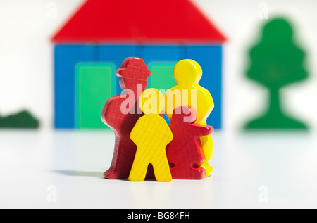 family model in front of house - Stock Photo