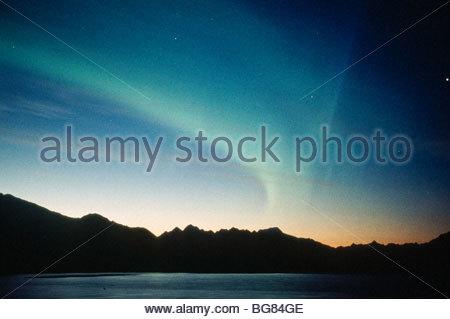 Alaska. Cordova. Aurora borealis or northern lights from the Million Dollar Bridge on the Copper River Hwy. - Stock Photo
