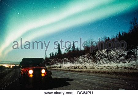 Alaska. Anchorage. Aurora borealis or northern lights above Jeep at Arctic Valley. - Stock Photo
