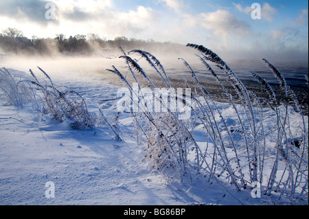 Blowing snow and steam from the still unfrozen Lake Mendota at Warner Park Beach in Madison, Wisconsin. - Stock Photo