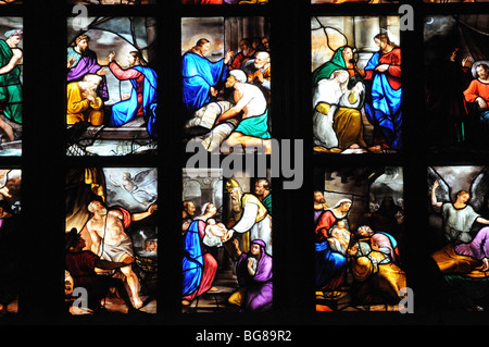 Detail of beautiful stained glass windows in il Duomo di Milano Milan cathedral Lombardy Italy - Stock Photo