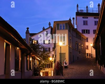 Switzerland, Zurich,street scene at dusk in Old Town of Zurich - Stock Photo