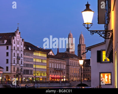 Switzerland, Zurich,Old Town Zurich and Limmat River front with Grossmunster Church at dusk - Stock Photo