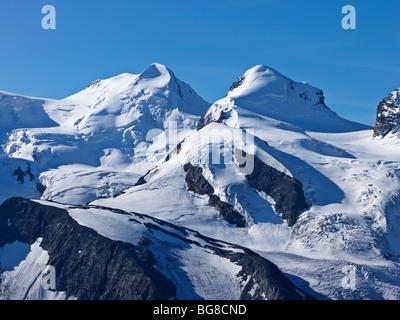 Switzerland, Valais, Zermatt, Gornergrat,peaks of mount Liskamm and Breithorn as viewed from the Gornergrat - Stock Photo