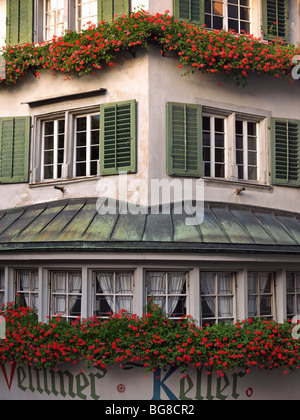 Switzerland, Zurich,exterior of a building in Old Town Zurich with window boxes of geraniums - Stock Photo
