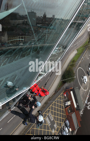 BBC 'Blue Peter' presenter Joel Defries window cleaning for the program at the Sage Gateshead in Newcastle upon - Stock Photo