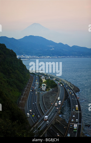 Aerial view of the Tomei Expressway. In the background, the silhouette of Mount Fuji. Japan. - Stock Photo