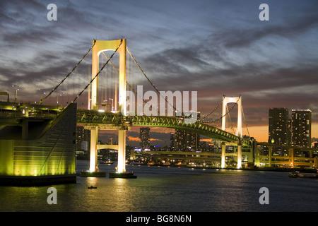 Tokyo. Rainbow Bridge over Tokyo Bay at sunset. Japan. - Stock Photo