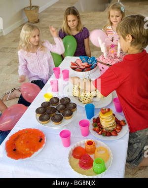 small childrens kids around table with sweets and cakes stock photo - Small Childrens Images